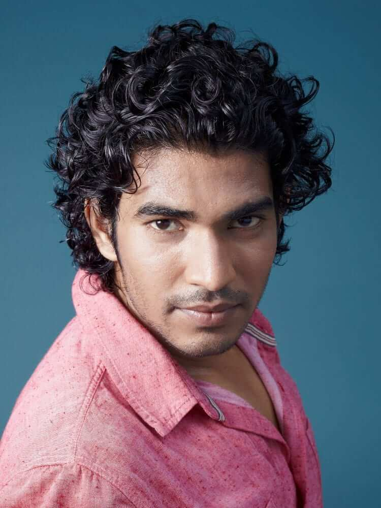 Long curly haircuts for Men with Thick Hair